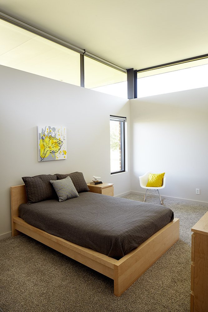 """The client served as the structural engineer and the general contractor, so the collaboration with the architect was very intimate on multiple fronts,"" Shelton says.  Bedrooms by Dwell from The Missouri Prairie Has Super Modern Architecture, Too!"