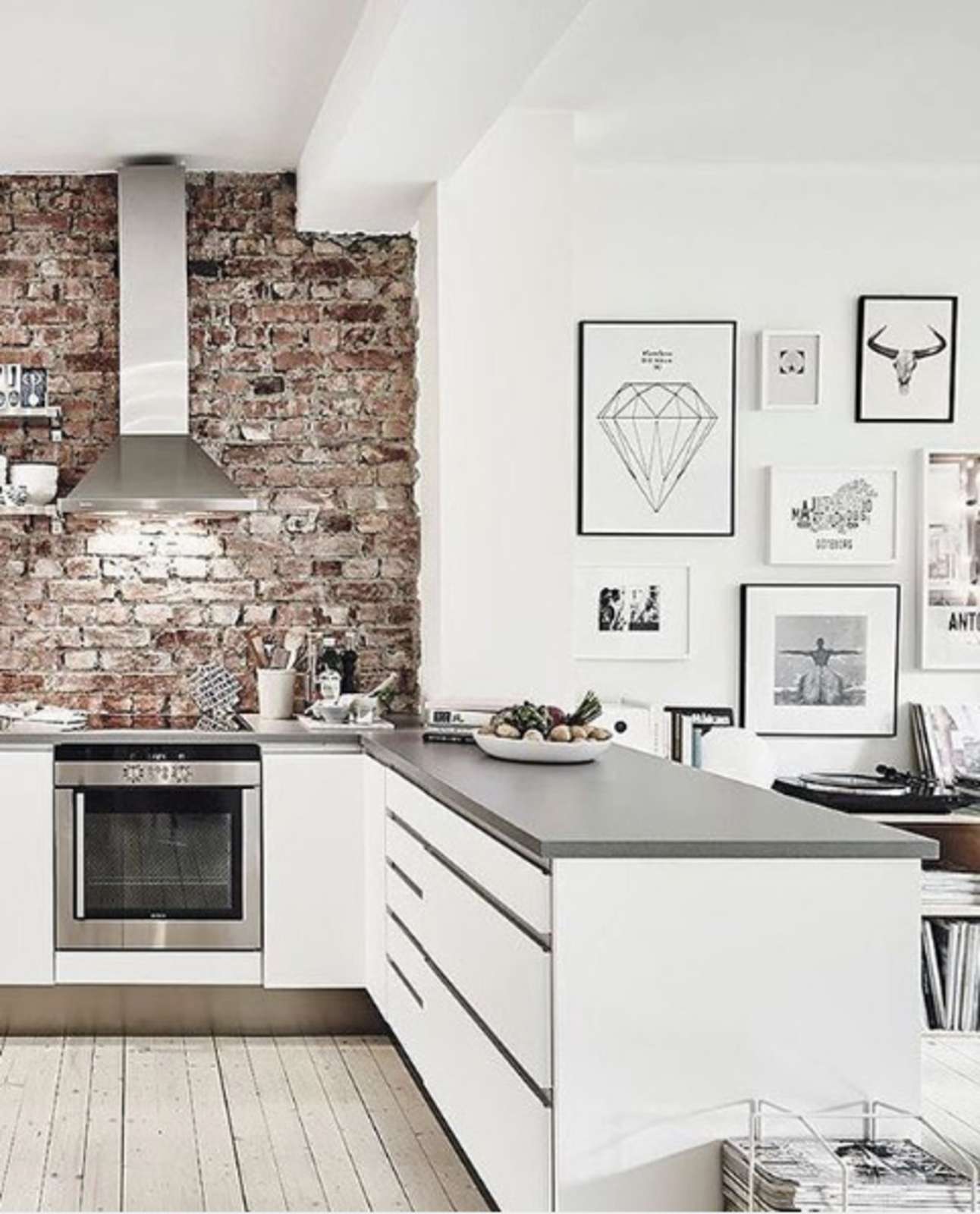 With an exposed brick wall and mesmerizing graphic art, this kitchen, posted by @abigailclaireinspo, feels particularly on-trend. exposed brick by Kate Reggev