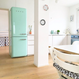 The Eco-Friendly Guide to Upgrading an Existing Home - Photo 8 of 8 - @solebich shared this photo of a bright kitchen-dining area with a turquoise Smeg refrigerator.