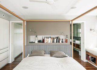 How to Take a Dwell Photo - Photo 6 of 19 - An Alcova bed from B&B Italia dominates the master bedroom. A niche behind the bed holds Berenice wall lamps by Luceplan, and the walls are painted in Cornforth White and Charleston Gray from Farrow & Ball.