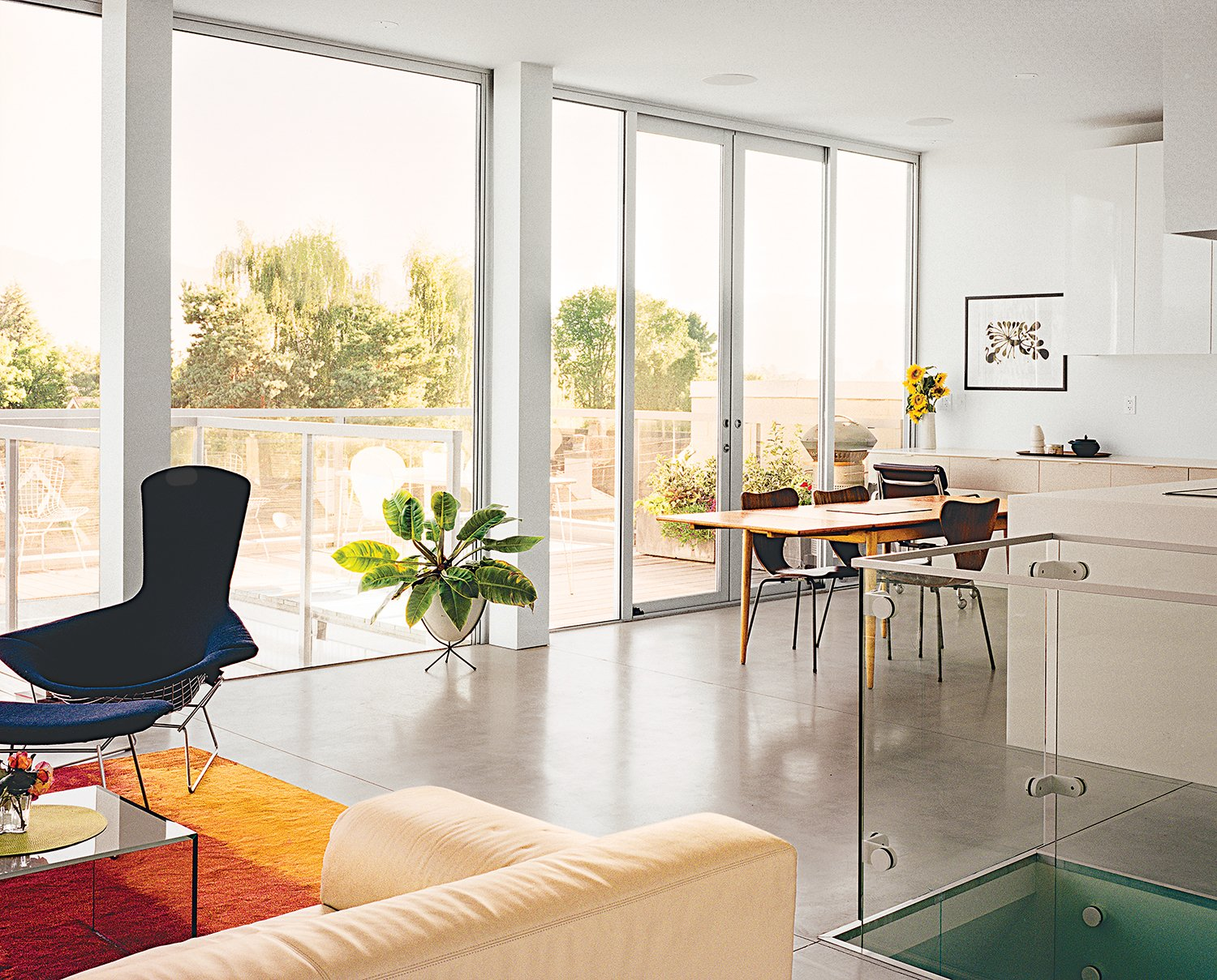 The living-dining area of their own residence is lined with doors and windows from Phoenix Glass for Columbia Aluminum Products. A Modern Multiunit Prefab Prototype in Vancouver - Photo 1 of 7