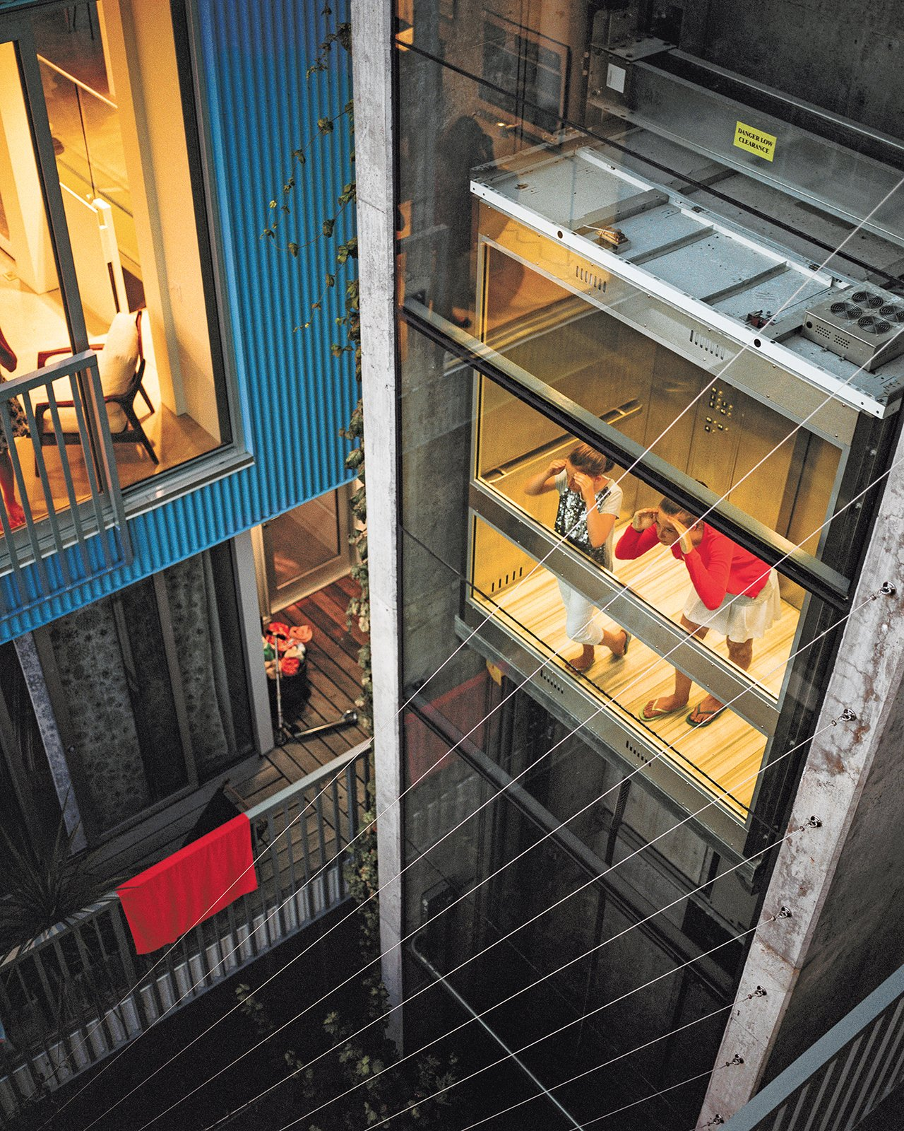 "The couple's daughters, Fiona and Olivia, try out the central elevator, which is shared by all the owners and tenants and was designed, says Lang, ""to encourage neighbor interaction."" A Modern Multiunit Prefab Prototype in Vancouver - Photo 4 of 7"