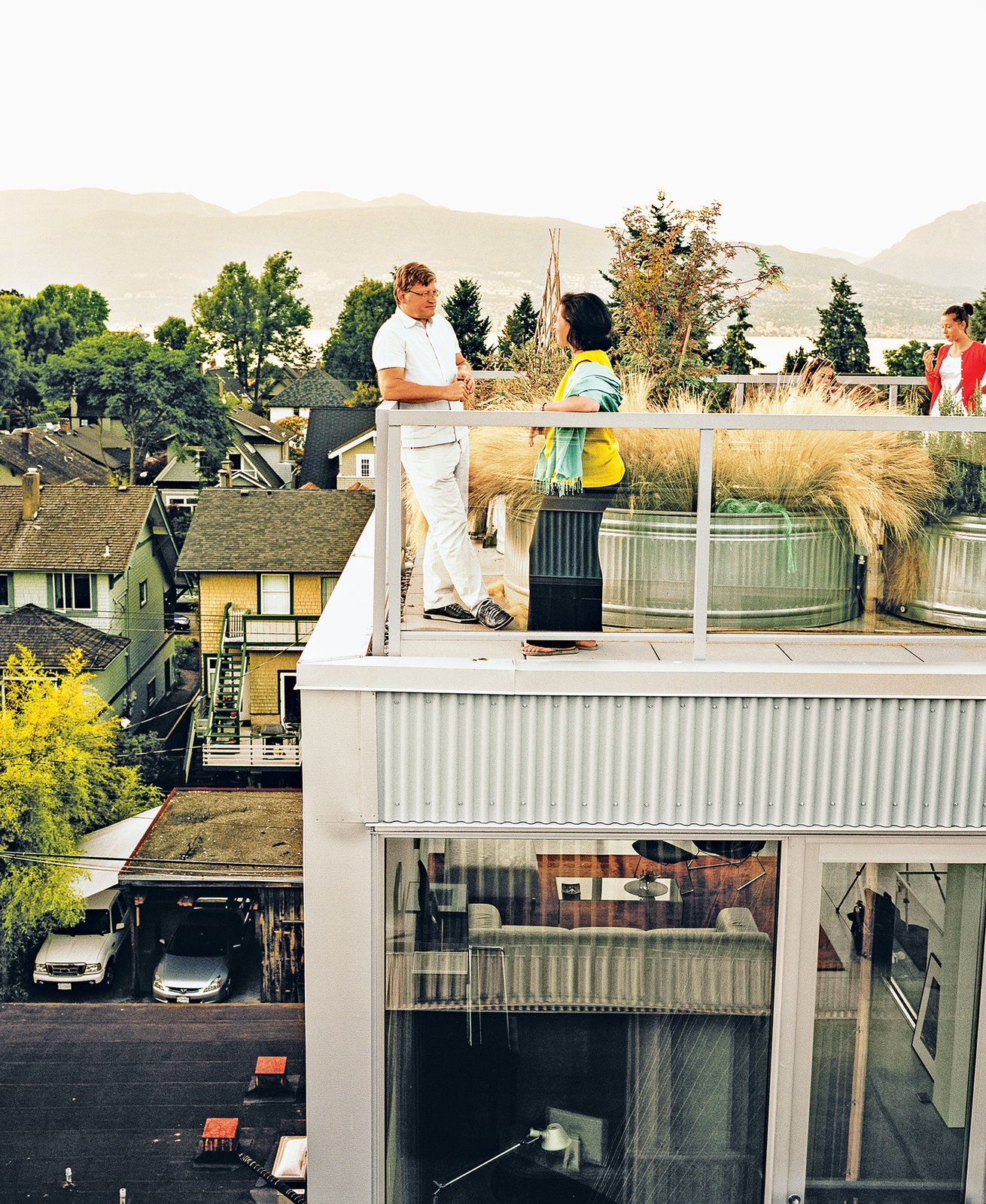 Each of the residences has outdoor space attached to it; the family's unit has a roof deck. In   lieu of a green roof is a galvanized tub filled with grasses—a collaboration between the architects   and landscape architecture firm space2place.  Modern Spaces in the Pacific Northwest by William Lamb from A Modern Multiunit Prefab Prototype in Vancouver