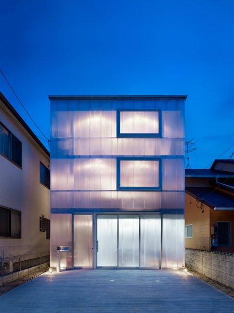 A glowing home in Japan has milky-white, one-and-a-half-inch plastic sheets wrapped around the exterior to let in light and provide insulation. Tagged: Exterior, Flat RoofLine, and House.  16 Funky Facades by Andrea Smith from The Home That Glows in the Dark
