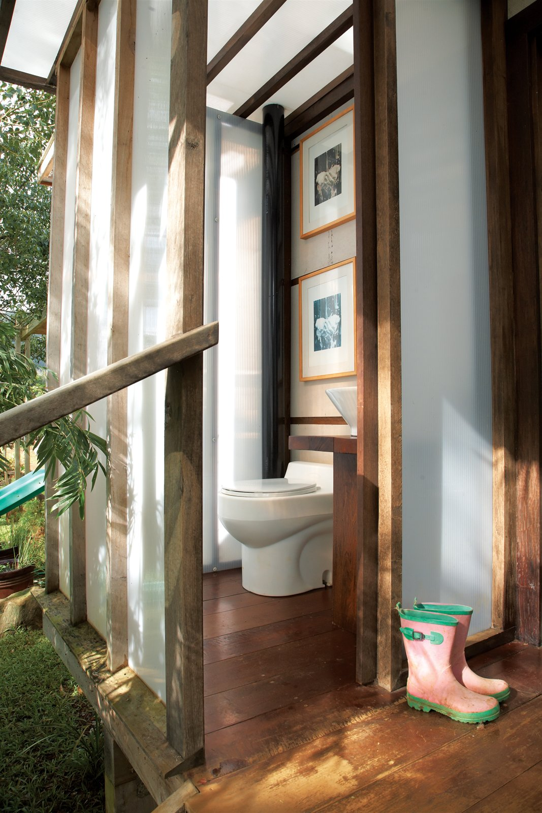 Nearby, the bathroom includes a composting toilet and a Home Depot sink on a pedestal Chris made from chunks of found wood.