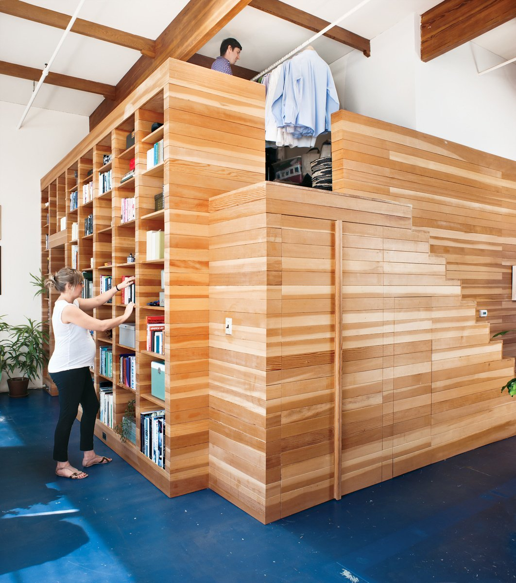 California homeowners Lynda and Peter Benoit designed a functional wooden structure to store books, keepsakes, and clothes. Photo by: Drew Kelly