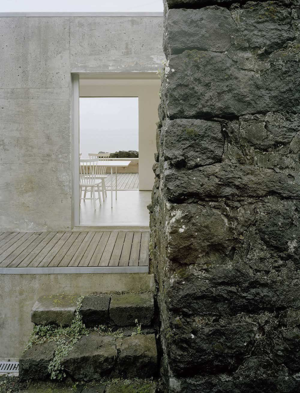 Strategic openings on the ground floor provide a clear view of the ocean.  This Modern Coastal Escape Sits Within 18th-Century Stone Walls by Patrick Sisson