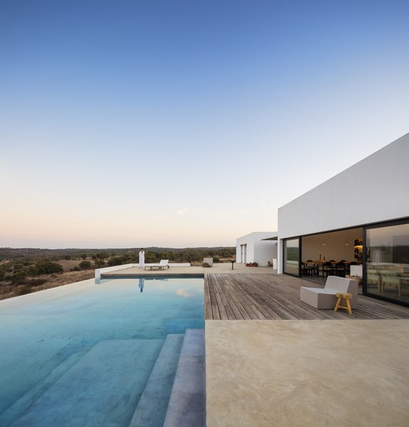 The 2,225-square-foot house was designed by ColectivArquitectura as a weekend home for a couple that runs a group of design, fashion, and lifestyle stores in Lisbon.