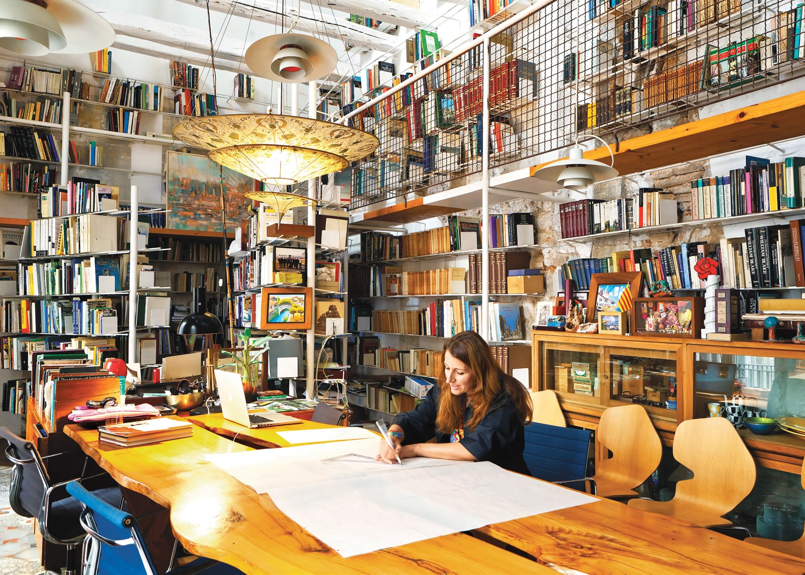 In her library, Tagliabue works at a table designed by Miralles.  Photo 2 of 23 in The Barcelona Home Like No Other