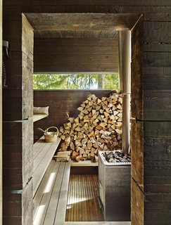10 Sterling Saunas in Modern Homes - Photo 9 of 9 - A traditional wood-burning stove fuels the earthy sauna in this Finnish home by Bengt Mattias Carlsson.