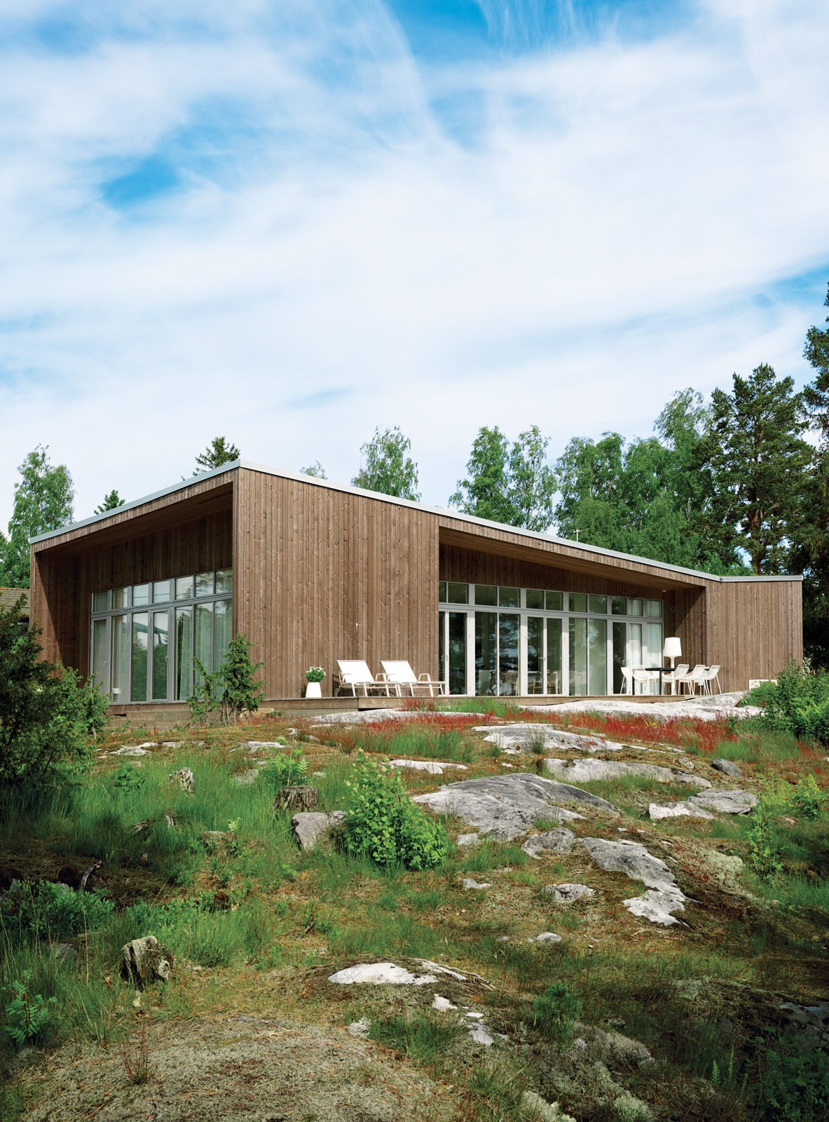 Prefab house in Muskö, Sweden Tagged: Exterior, House, and Wood Siding Material.  Prefab Homes by Dwell from An Asymmetrical Prefab Home in Sweden