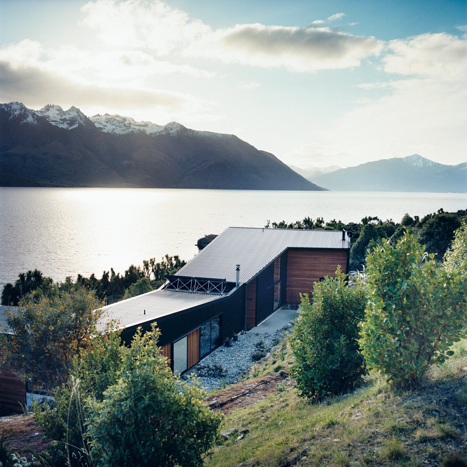 The home is made up of two parts: a rear wing containing the studio and a guest room, and the north-facing living quarters (which, in the southern hemisphere, attract the most sun) overlooking the lake.  Photo 7 of 12 in Nature Nurtured
