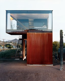Xeros Effect - Photo 5 of 7 - The glass-enclosed master bedroom floats above the corrugated, oxidized steel exterior.
