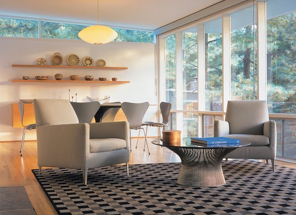 The Wilson's living and dining rooms are outfitted with furniture from B&B Italia, Fritz Hansen, Modernica, and Knoll.
