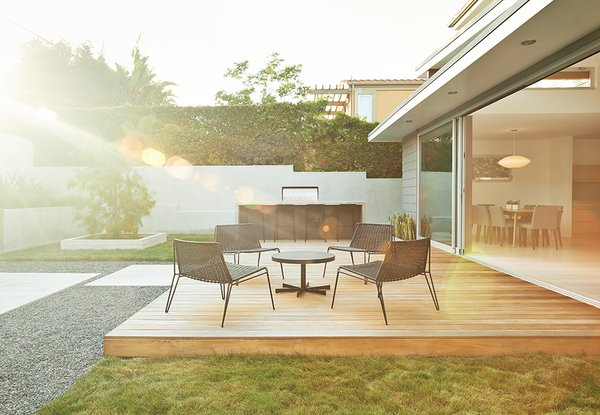 Sweet's renovation scheme included recreating the couple's backyard as a natural extension of their living room.