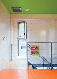 Color Me Mad! - Photo 11 of 31 - The house has many unexpected splashes of color, and exposed industrial materials are used throughout. The diamond-plate steel shown here was also used as a kitchen backsplash, covered with a coating of pink paint.
