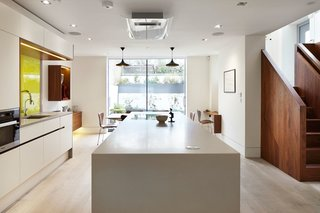 10 Best Modern Kitchens - Photo 9 of 10 - This formerly dark basement kitchen now feels much lighter, thanks to the addition of white oak floor boards, bright plaster walls, and floor-to-ceiling windows that let in garden views.