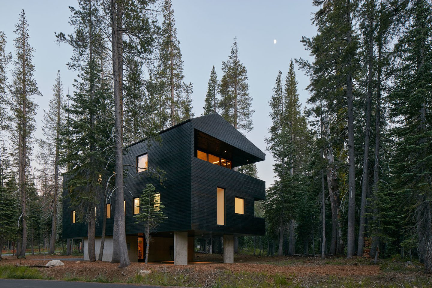 The exterior timber cladding is coated with black tar, a traditional Norwegian treatment. The finish serves a variety of purposes: solar heat gain, water resistance, and insect repellant.  Modern Winter Retreats by Aileen Kwun from Here's What Norse Mythology and Modern Architecture Have in Common