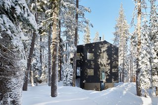 "101 Best Modern Cabins - Photo 96 of 101 - Construction during Lake Tahoe's snowy season posed the biggest building challenge. ""We shrink-wrapped the building, so the contractor could continue working through the cold of winter, sparing the expense of continuous snow removal, and limiting traces of the process on the landscape. Snowmobiles and sledges were used to bring workers and construction materials to the site."" Casper says."