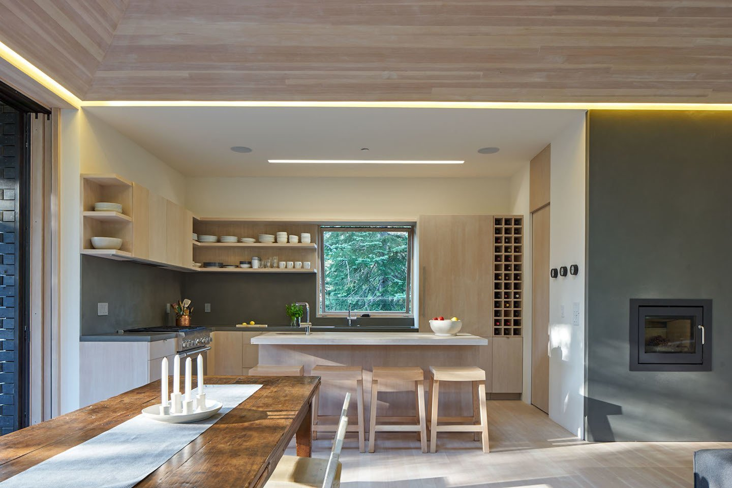 The open-plan kitchen serves the family's needs for easy entertaining. The four bar stools are also custom designed by Lexie and were built by Yvonne Mouser. Here's What Norse Mythology and Modern Architecture Have in Common - Photo 4 of 7