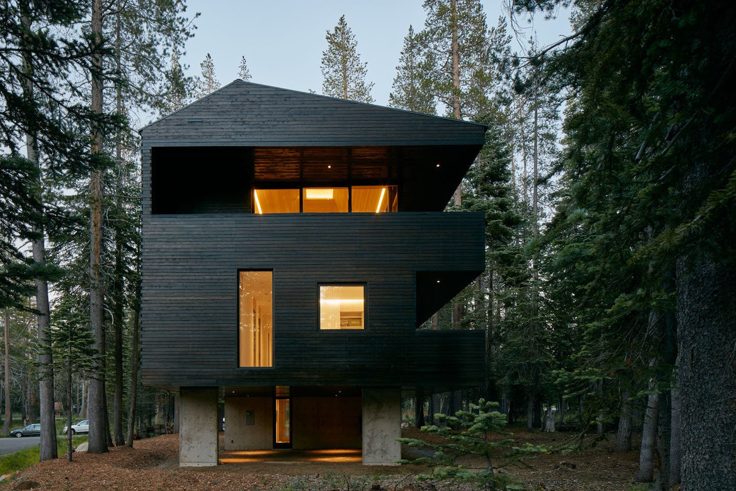 """Taking inspiration from Arlberg Valley, Austria to classic Nordic materials, the Troll Hus certainly adds a European touch to the California landscape. """"The inspiring concept is that of a treehouse that, as if suspended between treetops, seamlessly and ingeniously blends with its surroundings."""" Casper says. Tagged: Exterior, Wood Siding Material, and Cabin Building Type.  Sweden by Hannah Eriksen  from Here's What Norse Mythology and Modern Architecture Have in Common"""