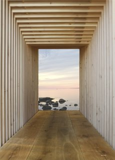 "Kajakhuset by In Praise of ShadowsThis ""kayak house"" is a sleek boathouse with a utilitarian interior that can be adapted for myriad other uses. Constructed like Legos from similar pieces of wood, the structure is capped by two glass doors."