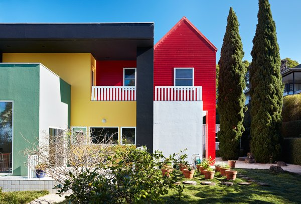 "Though seemingly whimsical and freewheeling, Sottsass was exacting in his designs: He had forbidden the Olabuenagas from repainting the home's stucco facade, insisting that they let it ""metamorph into what it wants to be,"" but the couple ultimately decided to restore its faded colors last fall, using new elastomeric Behr paints that were blended to original specifications.  Photo 11 of 14 in Thank Sottsass for the Most Memphis House Imaginable"