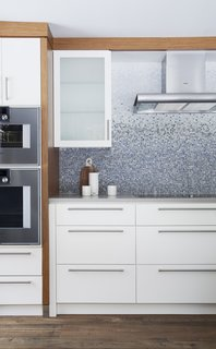 12 Brilliant Kitchen Backsplash Ideas - Photo 5 of 12 - In Ontario, this 19th-century home abuts a river, where the residents enjoy kayaking and swimming in warmer months.  This geographic location partially inspired the wave-like backsplash. Each tile was hand-cut and individually placed by artisans from New Ravenna.