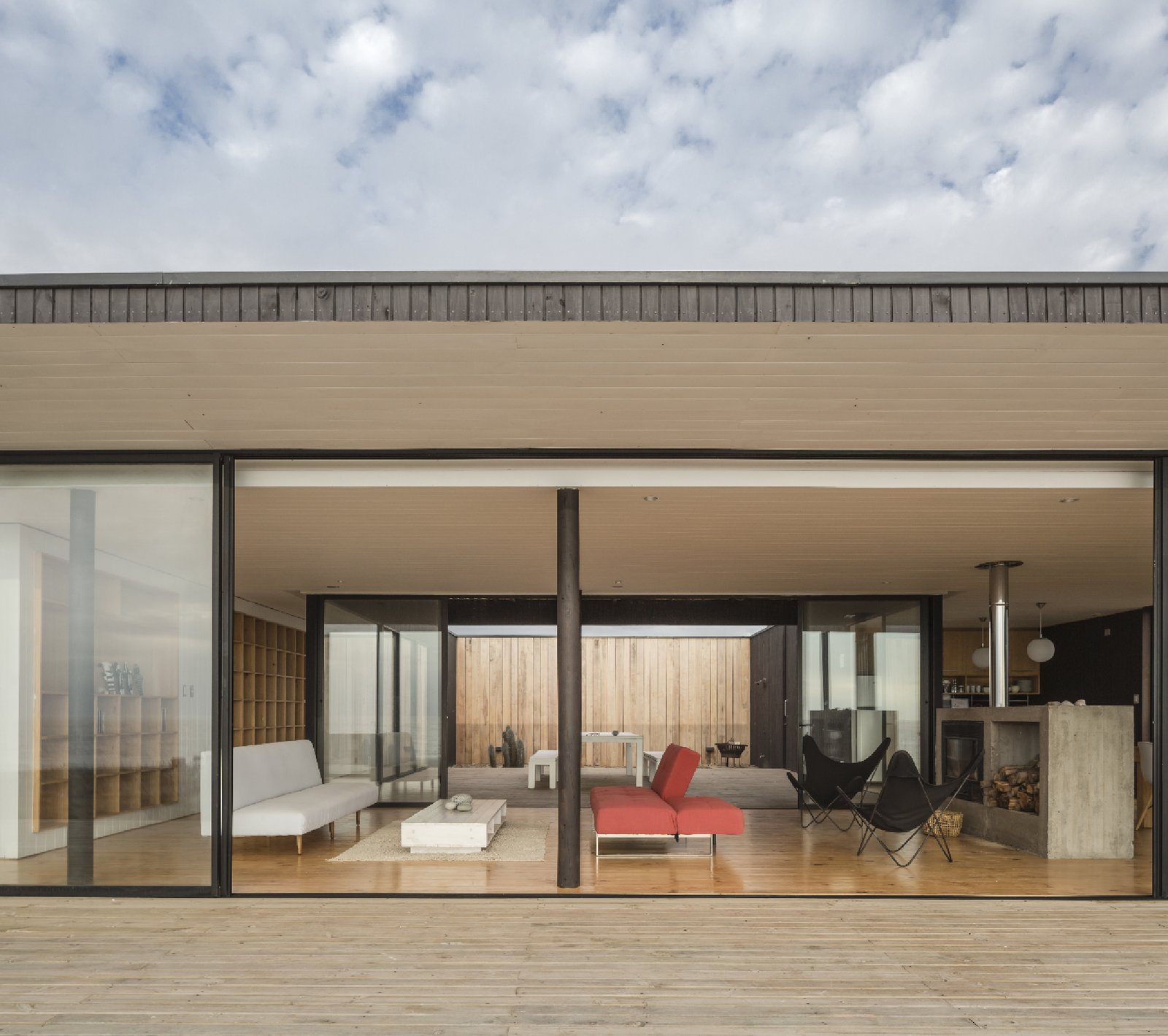 Aluminum lines the glass windows that divide the living spaces from the airy patio.  Unplugged by Kelly Dawson