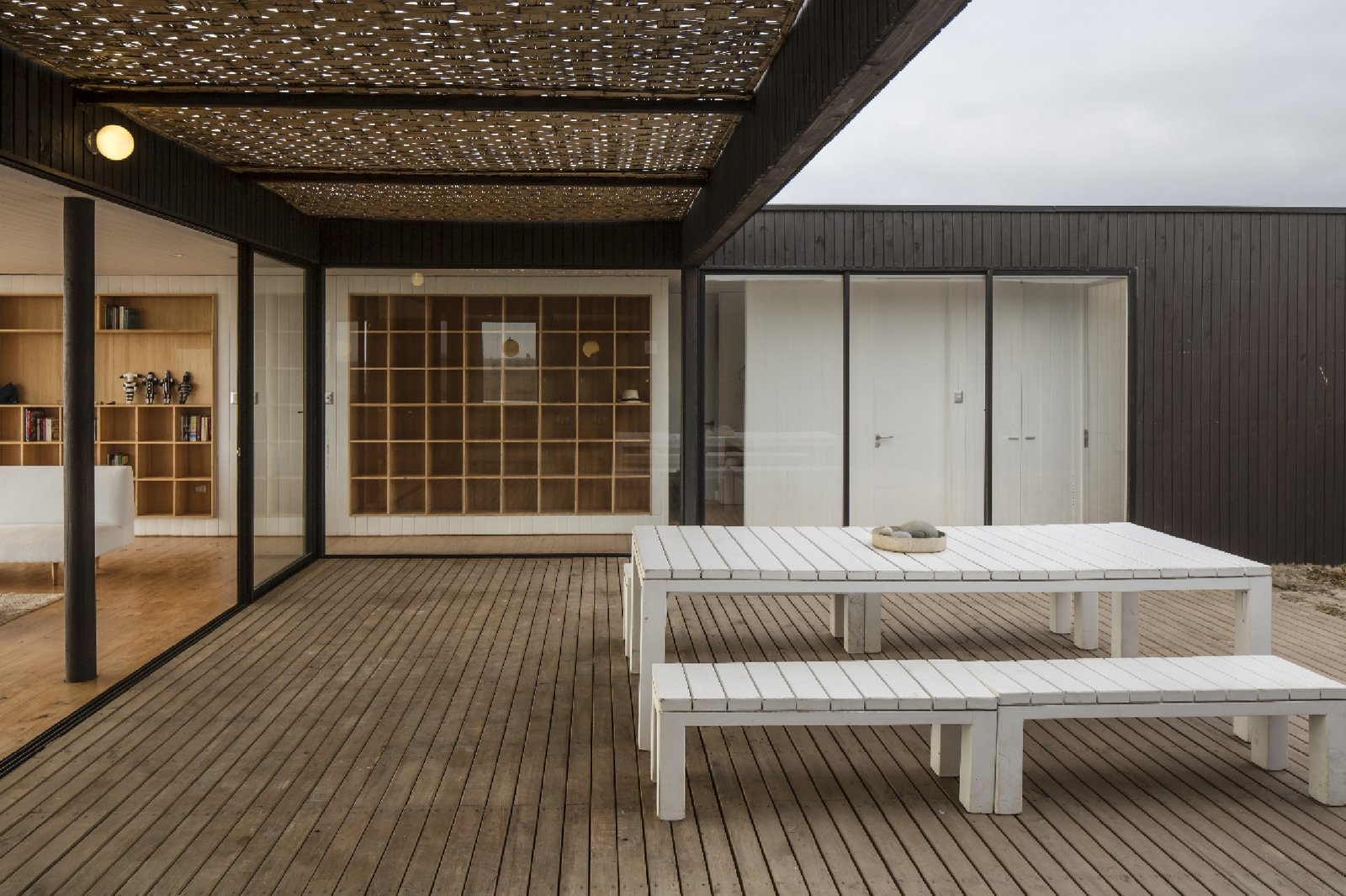 """The program of enclosures was developed around a courtyard that is protected from the constant wind. The transparency of the main facade brings the presence of the sea inside the house,"" LLaumett says.  Unplugged by Kelly Dawson"