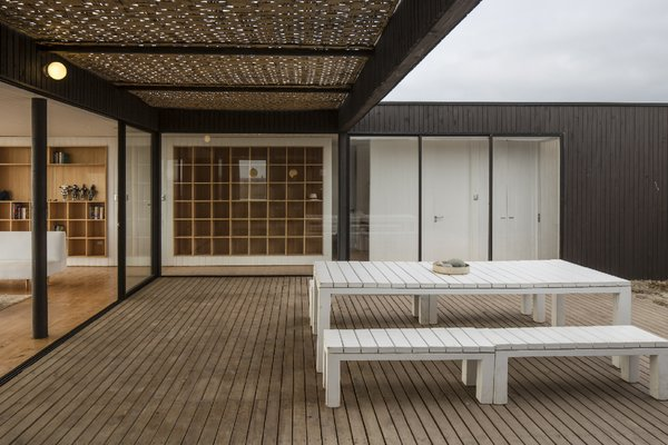 """The program of enclosures was developed around a courtyard that is protected from the constant wind. The transparency of the main facade brings the presence of the sea inside the house,"" LLaumett says. Photo 5 of Unplugged modern home"