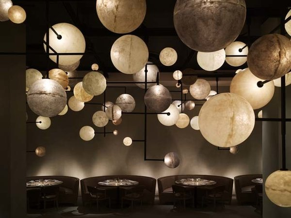 Public, Chicago   Ian Schrager's Public Chicago, designed by Yabu Pushelburg, achieves its aim of being both sophisticated and affordable. A muted color palette allows accents to emerge. The array of planetary lights in the hotel's bar, Pump Room, is a prime example.