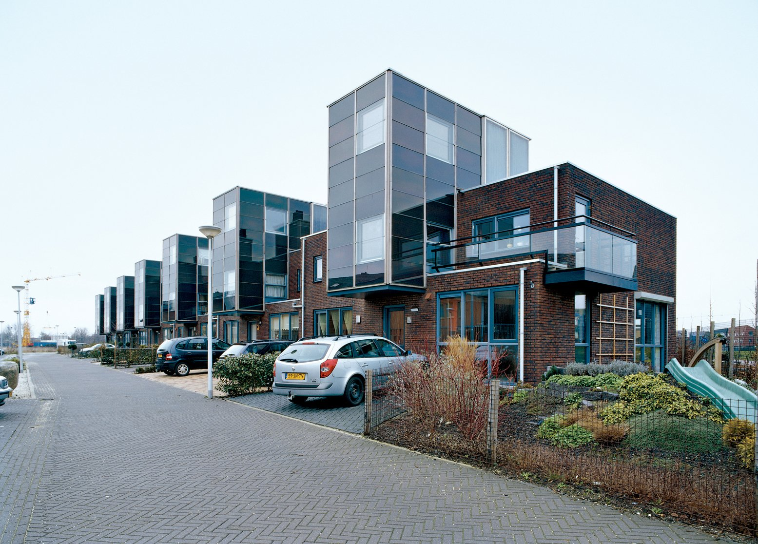 "Arranged and slotted together like a tidy row of Legos, the IJsselstein housing project reflects typical Dutch efficiency, ""not just in terms of materials used,"" notes architect Gregory Kiss, ""but in terms of space as well.""  Photo 1 of 3 in Run by the Sun"