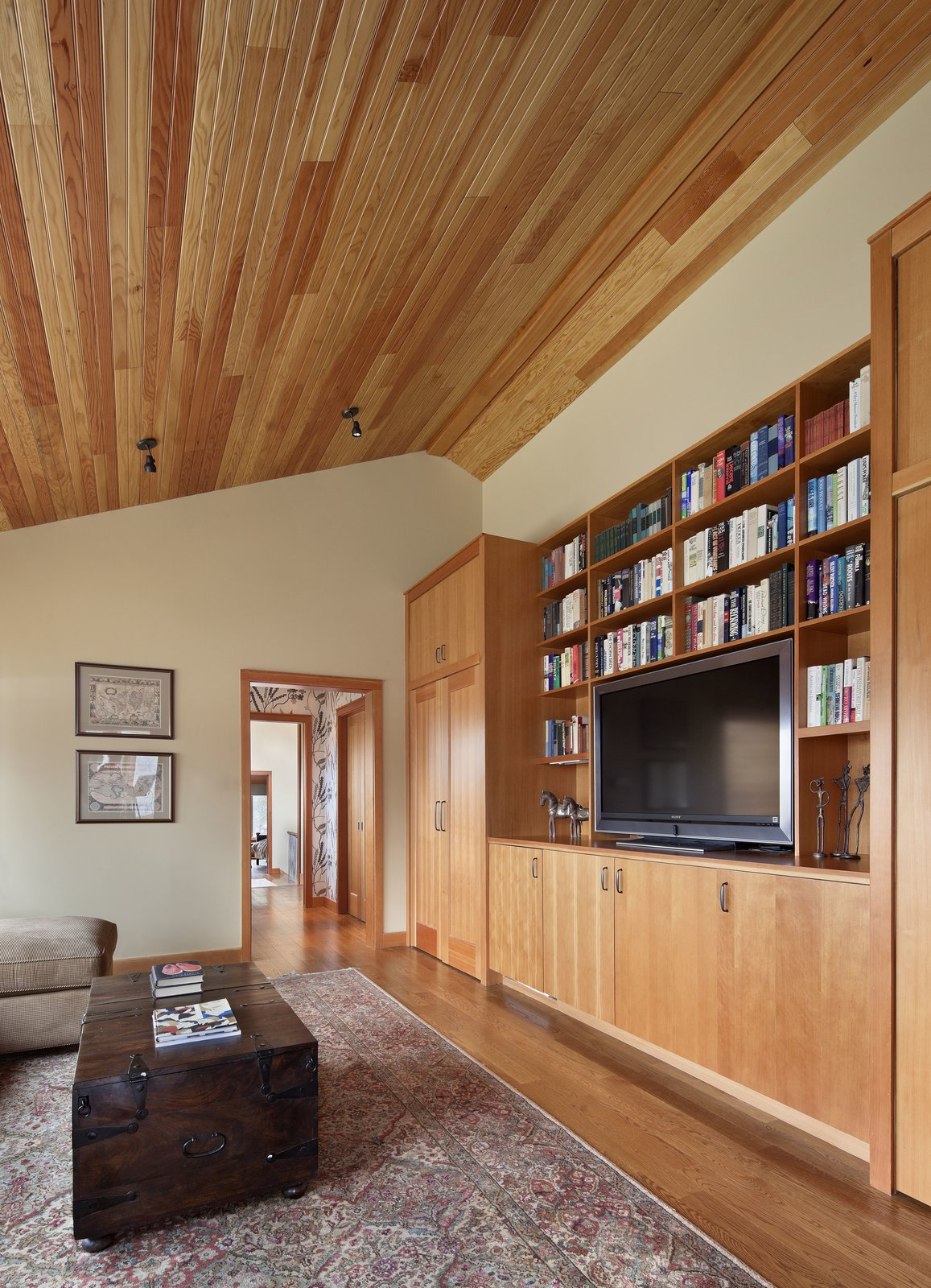 The second floor den, outfitted for the homeowners' 12 grandchildren, serves as a versatile and cozy gathering place for the entire family.  Photo 4 of 7 in After a Fire, a Midcentury Home Rises from the Ashes