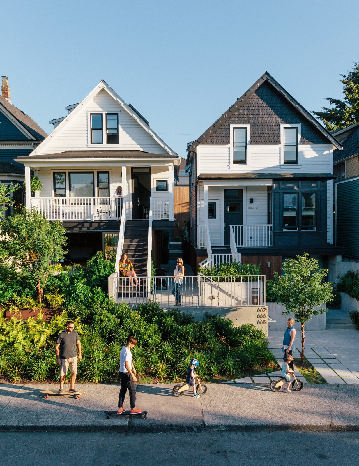 In Vancouver's Strathcona district, two side-by-side lots now hold seven residences—thanks to a thoughtful renovation of a pair Edwardian houses and the addition of a laneway, or alley, building by Shape Architecture. The team salvaged as much 120-year-old siding as they could for use on the street-facing facades. Tagged: Exterior and House.  Best Photos from As Housing Costs Soar, Two Homes Multiply to Seven