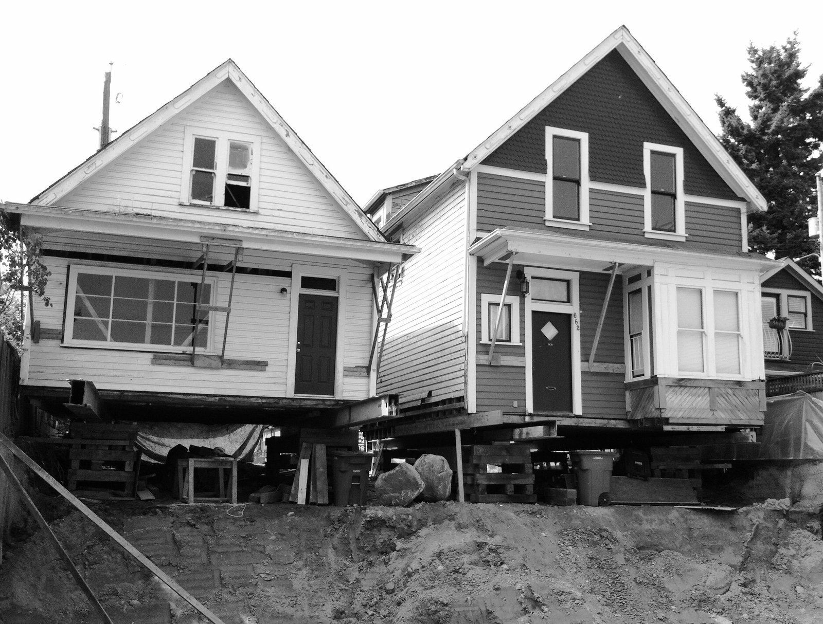 The original structures were lifted from their foundations to accommodate new ground-floor units.  Photo 2 of 7 in As Housing Costs Soar, Two Homes Multiply to Seven