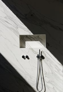 Mad About Marble: 20 Kitchens and Bathrooms - Photo 12 of 20 - A shaft of sunlight streams into the marble shower, through a glass atrium that connects the master suite to the outdoors while maintaining privacy; the fixtures are by Vola.