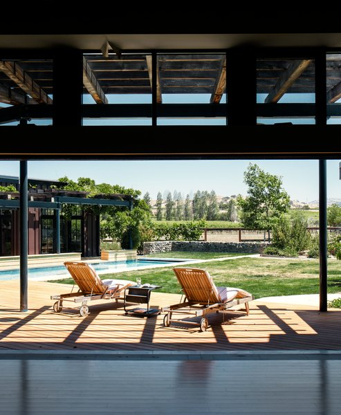 """Twenty-foot-wide doors from Solar Innovations offer easy access to the deck. """"Solar Innovations was the only manufacturer at that time that had a pocket multi-slider with a good ADA threshold,"""" says architect Erick Mikiten. """"They almost look like steel, but are thermally broken aluminum."""""""