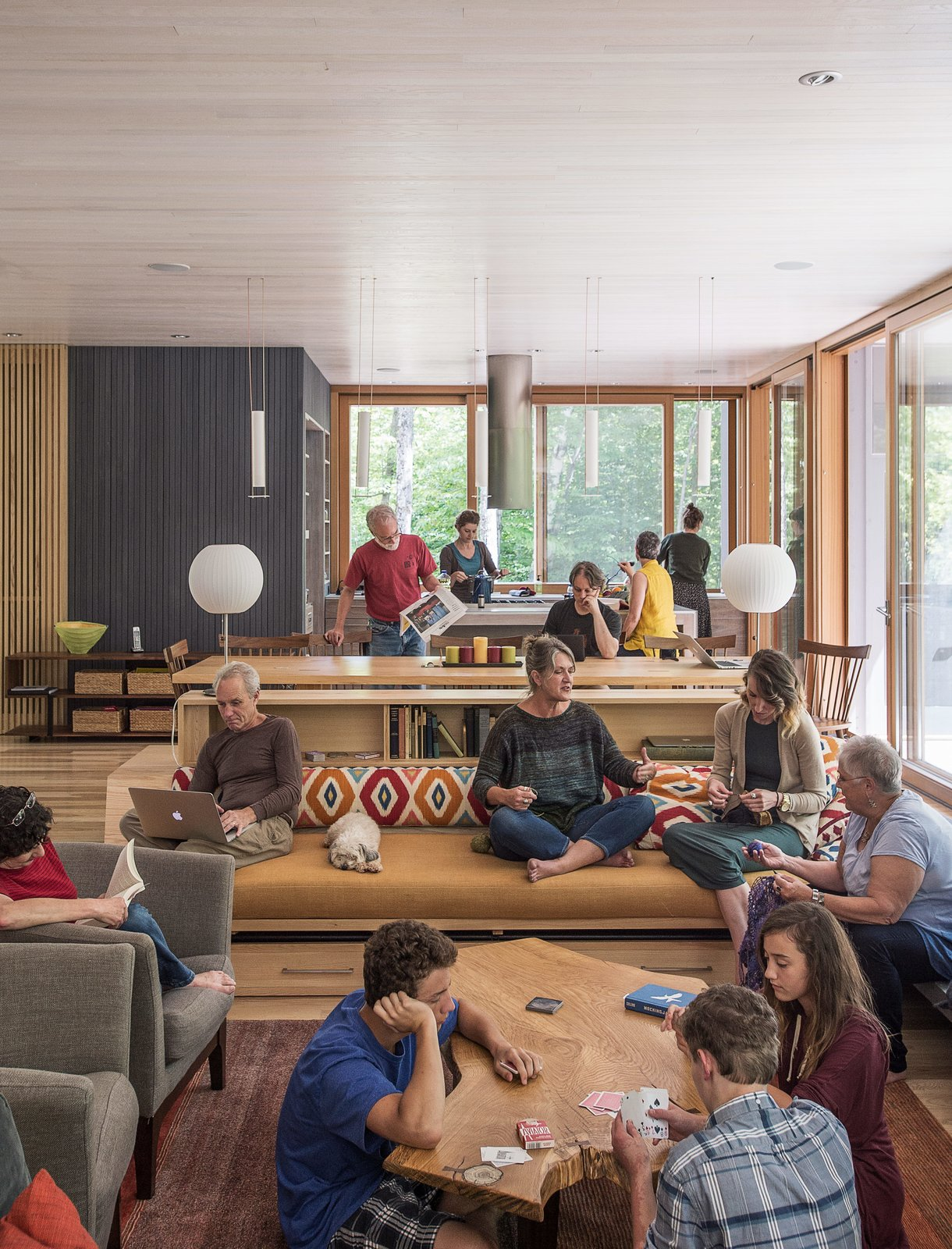 The extended clan, which includes about two dozen members, collaborated with Gray Organschi Architecture to design an inclusive home for three generations. Tagged: Living Room, Bench, Chair, Sofa, Coffee Tables, Ceiling Lighting, Table Lighting, and Recessed Lighting.  Examples of Modern Communal Living by Megan Hamaker from It Took a Whole Family to Build This House