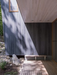 It Took a Whole Family to Build This House - Photo 3 of 13 - Custom-milled vertical groove tamarack clads the exterior.