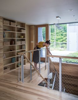 It Took a Whole Family to Build This House - Photo 4 of 13 - Beyond the second-floor landing, a garden roof filters rainwater and provides insulation.