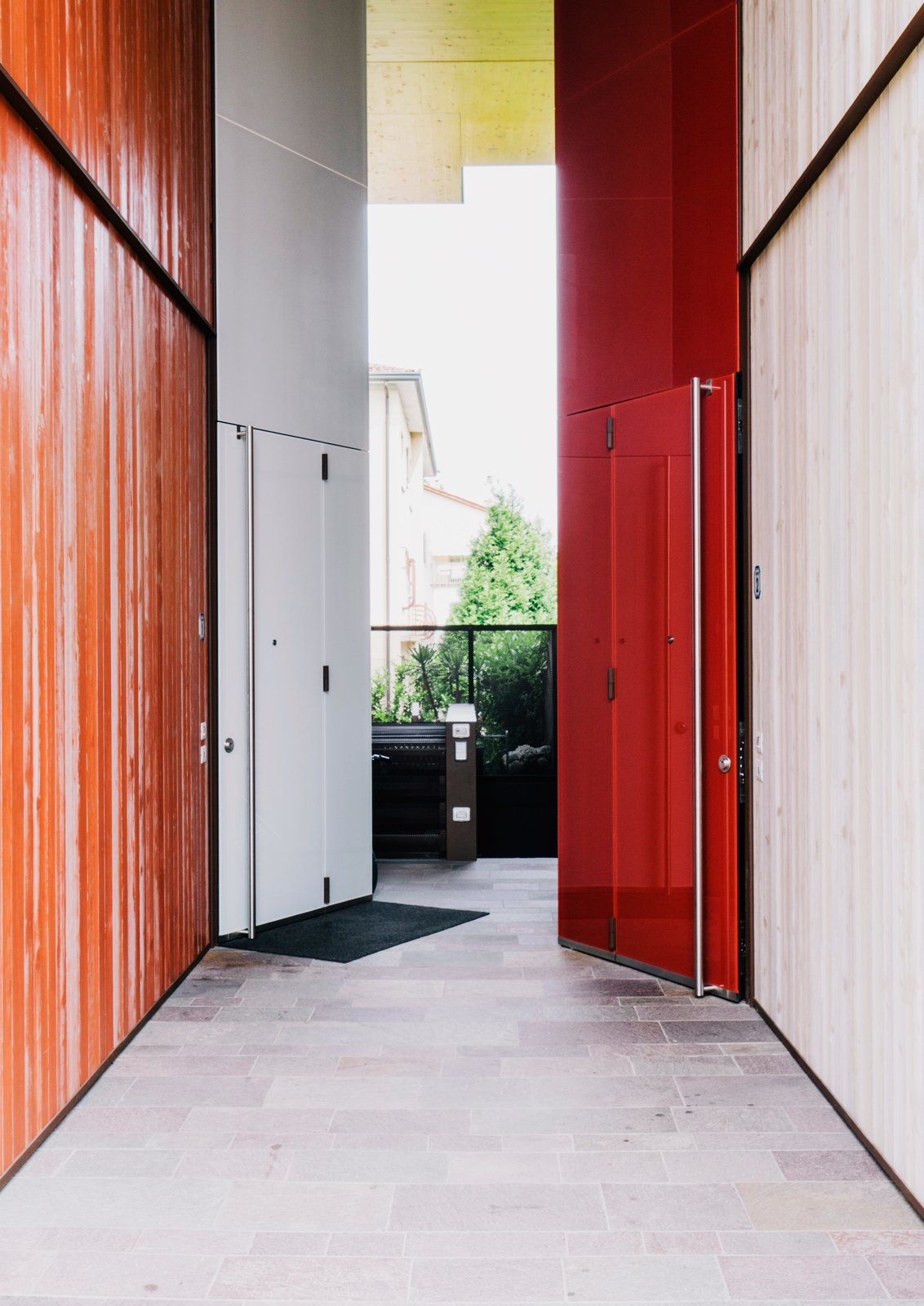 Color is one way the architects differentiated the structures, as in the custom doors they designed for the entrances in contrasting light and dark light finishes.  Photo 2 of 8 in Could You Share Your Dream Home?