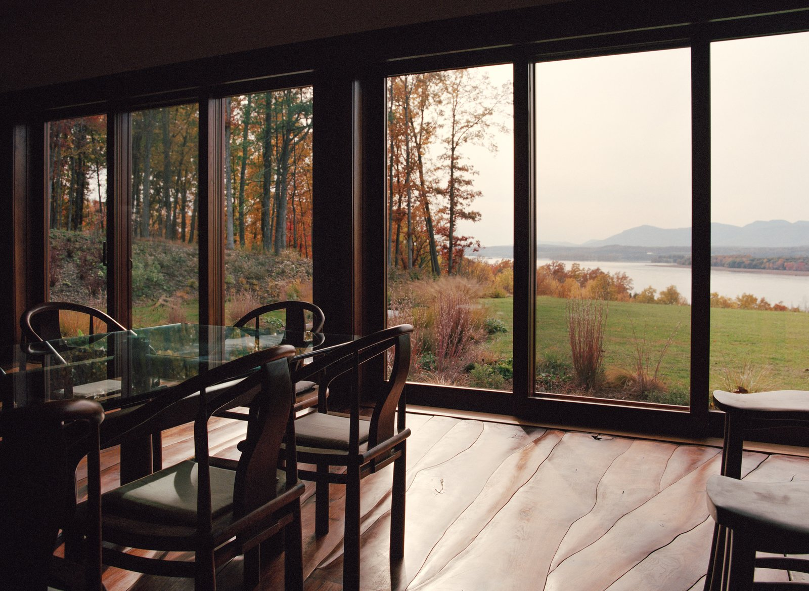 Overlooking the Hudson River, Allan Shope's nearly 3,000-square-foot sustainable home features handmade furniture and an undulating floor, all crafted from the site's felled black walnut trees. A House Not Built for Human Beings - Photo 1 of 9