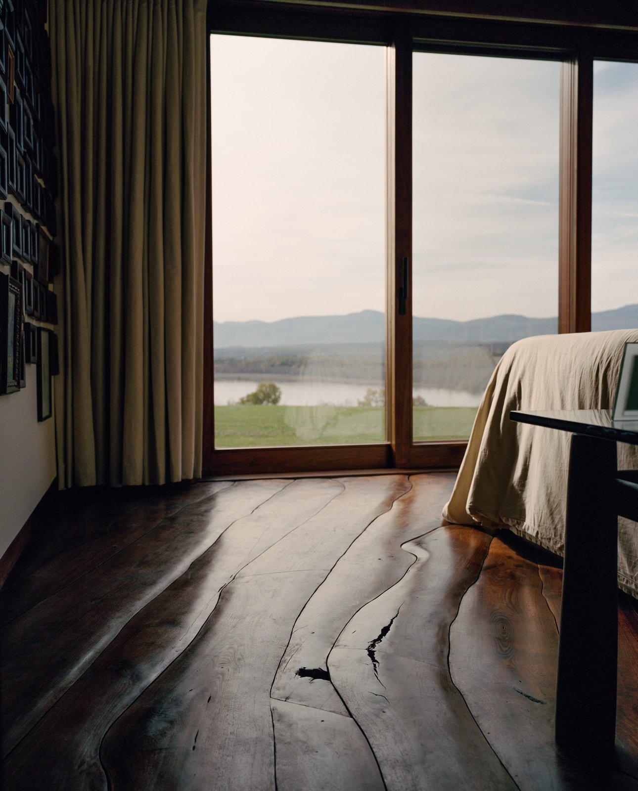 Open to the valley, the home lets the Shopes fully experience the seasons, even the sound of the Hudson River's ice cracking in winter. Tagged: Bedroom, Bed, and Medium Hardwood Floor.  Photo 6 of 9 in A House Not Built for Human Beings