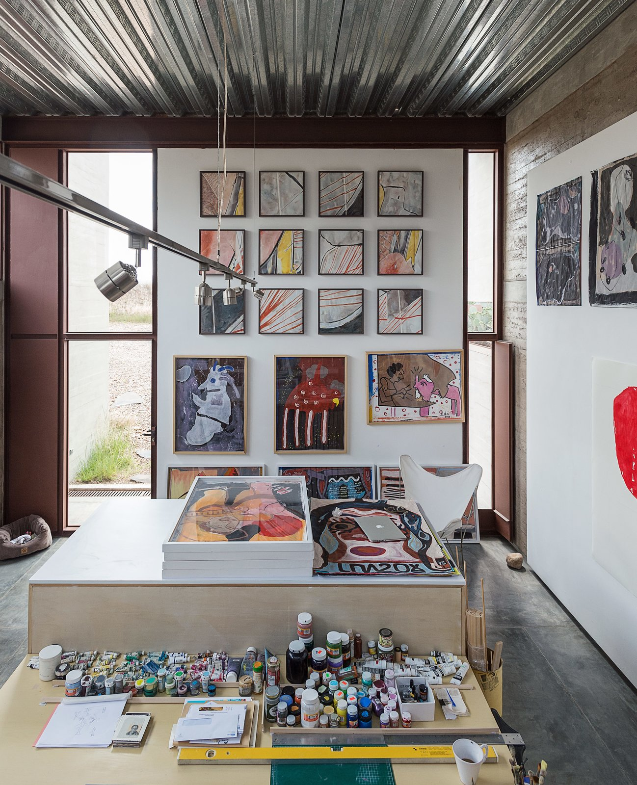 A workspace, bedroom, and bath comprise each of the two studios; an early riser, Lida spends most of the day painting in her space. Tagged: Office and Craft Room.  Photo 8 of 14 in These Separate Studios Keep a Retired Couple Happy