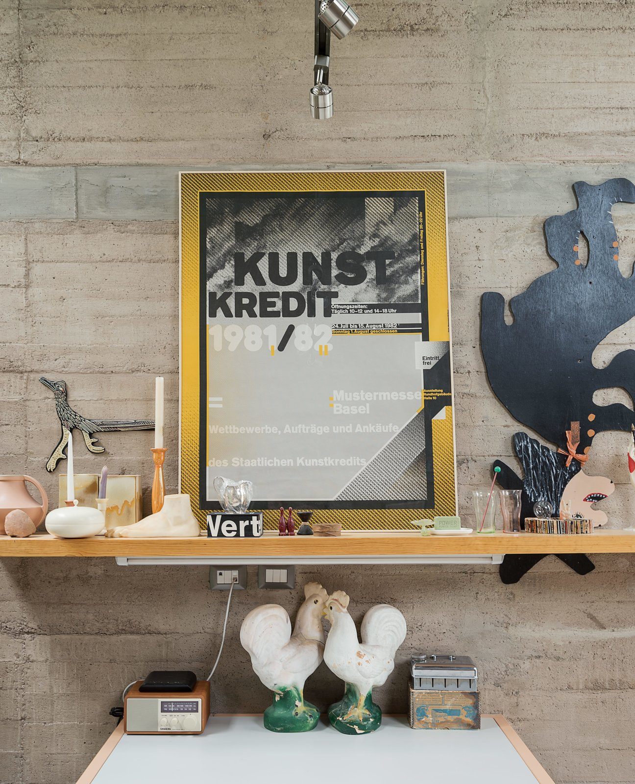 A collection of flea-market finds and personal keepsakes sit perched upon a shelf in Austin's studio. Tagged: Living Room and Shelves.  Photo 10 of 14 in These Separate Studios Keep a Retired Couple Happy