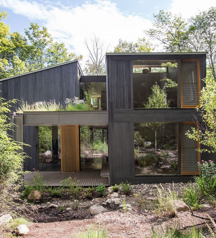 In upstate New York, two families unite to design a vacation house that will suit all their needs for years to come. Tagged: Exterior, House, and Wood Siding Material. A Dream Home is an Architectural Self-Portrait - Photo 4 of 5