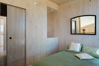 Learn How to Connect with Nature from This Off-the-Grid Prefab - Photo 3 of 9 - The bedroom is outfitted with only the basics.
