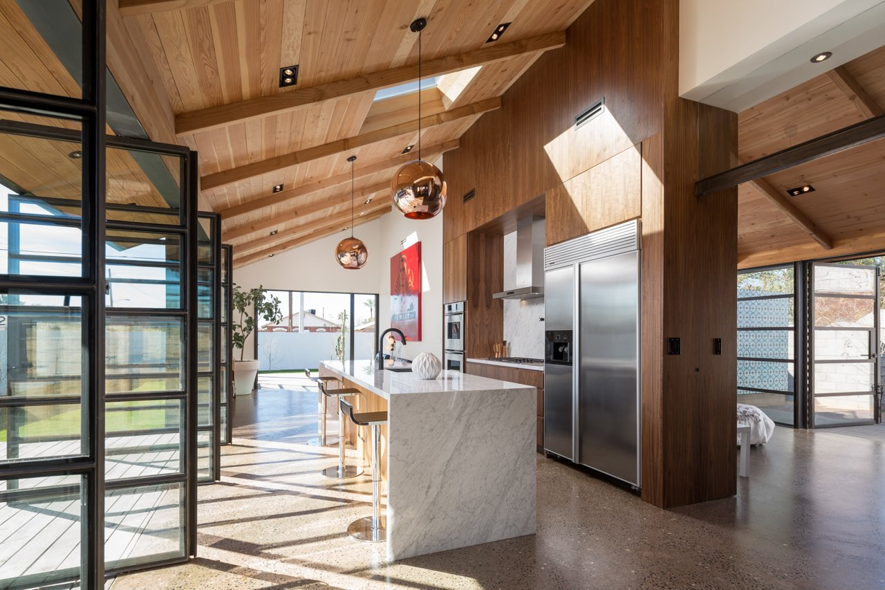 Contreras can take his breakfast at a polished marble bar overhung by Tom Dixon pendant lights. A walnut cabinet system reaches from floor to ceiling, dividing the kitchen from the master bedroom.  Photo 5 of 11 in Amazing House is Half Historic and Half Modern