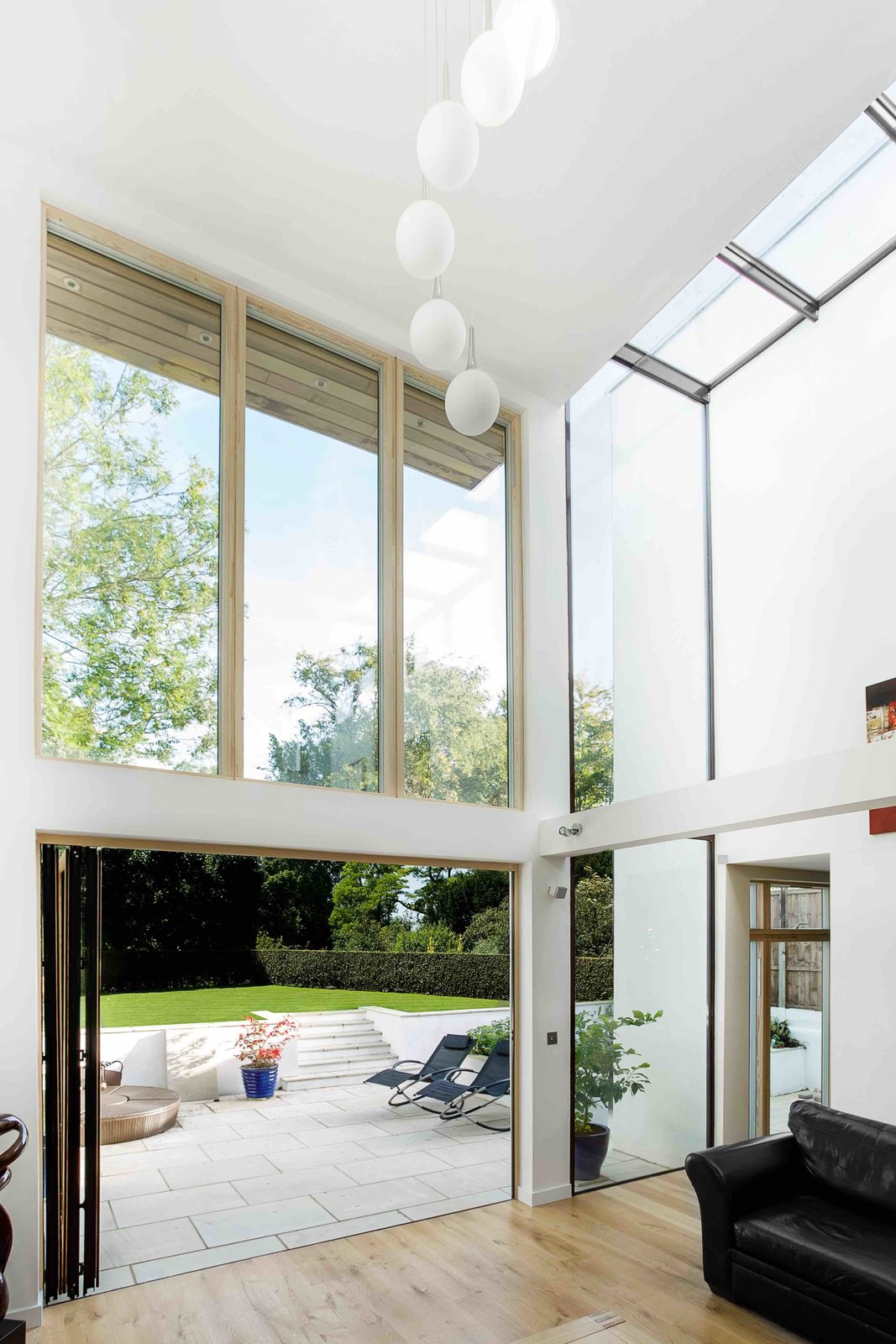 The home's defining quality is its airy, double-height spaces.  Wrap House by Luke Hopping